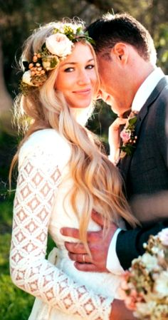 Bride's long down wedding hairstyle with flower crown