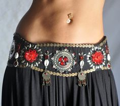 interesting design for front of belt. could translate to tassel belt pretty easily. make a triangular belt in back, then cover the front with an oval panel like this. use same afbric/brocade/embellishments as back. I think i'll have to make one! :)