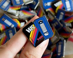 Blank VHS Pin. Comes with a black rubber clutch on the back. In stock now! Packed in a bubble envelope. Pin size: 28mm x 30 mm (measured from corner to corner)