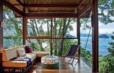 Beautiful glass living room overlooking the ocean.