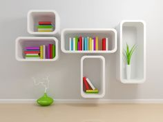 Accessories Ideas | Wall Bookshelves Advantages In Home Decor And Furnishing: Unique Wall Bookshelves In White Wall Finishing With Colorful Book Covers Also Green Flower Pottery