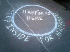 Happiness Graffiti and 8 More Photos to Brighten Your Day—Sometimes you just need a little reminder that happiness is closer than you think. Maybe even right there on the sidewalk beneath your feet.