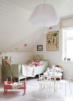 Love the pale green bed and bunting. Vintage.