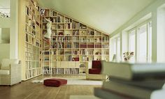 Floor to ceiling bookshelf - could i do this in the upstairs living room and have my rolling ladder? hmmmm
