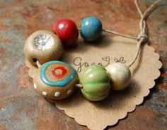 Protective Eye - Handmade ceramic tribal inspired bead design from Gaea.cc Ceramic Bead and Art Studio Blog