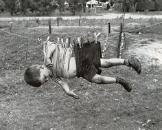 Boy on a clothes line, ca. 1950s-60s.