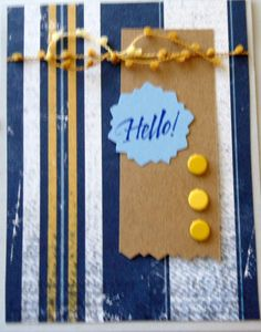 """Pretty simple - nice striped paper for background, a piece of thin cardboard with a cut edge. Used the same scissors to cut around the Hello and finished with 3 brads and a piece of """"twine"""" ribbon - a good """"guy"""" card..."""