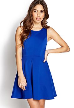 Classic Fit & Flare Dress. A scuba knit fit & flare dress featuring a round neckline. Sleeveless. Invisible zipper in back. Unlined. Lightweight.
