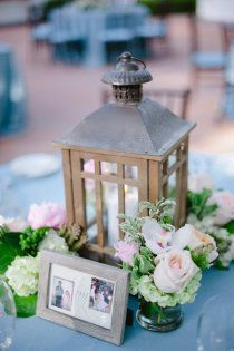 I like the idea of the little lanterns for the fat candles. I might use white lanterns, white picture frames for the bridal couple's photos and white milk glass vases for the flowers. I like this a lot. The much larger lanterns can be strikingly beautiful on the wedding stage as my best friend used for her daughter.