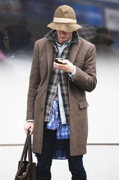 """right on the verge of """"homeless chic"""" until you look at that bag. Fantastic."""