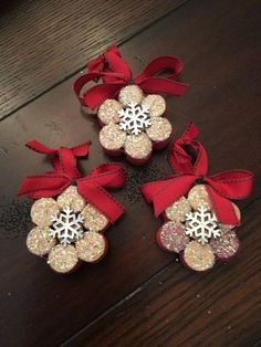 These snowflake ornaments are made from upcycled wine corks. They come in sets of 3, and all 3 will look like the ones pictured. These are sturdy and held together with glue and surrounded by glued-on ribbon. These ornaments look beautiful on the tree as the iridescent glitter catches the light, creating a lovely sparkle and shine.