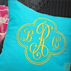 Would be sweet to have several of these made up to then use at home later | monogrammed turquoise pillow | Whimsical modern Garden party engagement | Ashley Gets Hitched | LFF Designs | www.facebook.com/LFFdesigns
