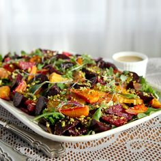 Recipe for roasted beet and citrus salad served with mustard vinaigrette. Roasted beets, oranges, grapefruit, shaved fennel, & pistachio over mixed greens.