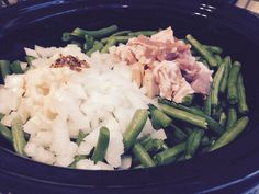 Fresh green beans in the crock pot in chicken broth, onion and bacon
