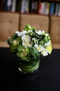 Icy chartreuse greens and whites. Flowers include hydrangea, dahlias, roses, parrot tulips, snowberry and brassica cabbage.