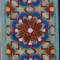 Moroccan tiled border in a traditional fez interior.