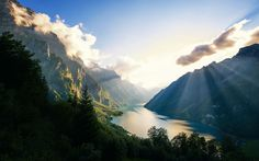 """""""Empire of the Alps""""  by """"Dominic Kamp"""" from http://interfacelift.com -Klöntalersee is a natural lake in the Canton of Glarus, Switzerland. Since 1908, it has been used as a reservoir for electricity production. The dam's construction substantially increased the lake's volume.  This is certainly one of my favorite lakes in Switzerland!  Adobe Photoshop CS, Nik Color Efex. -- Available as #wallpapers in any resolution at: http://interfacelift.com/wallpaper/details/3935/empire_of_the_alps.html"""