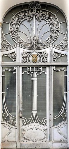 Amazing silvery art deco door and window decoration.  in Berlin - Jugendstil 006 by Arnim Schulz, via Flickr.