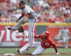 Cincinnati Reds' Billy Hamilton (6) steals second base against Washington Nationals shortstop Ian Desmond in the third inning of a baseball game, Saturday, May 30, 2015, in Cincinnati.    -   © AP Photo/John Minchillo