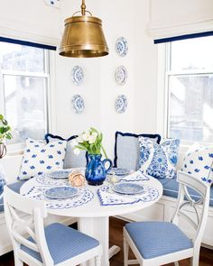 white table & white chairs with blue cushions
