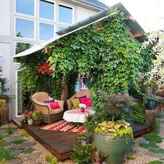 "Embrace Vines: Vines are the ultimate plant for providing privacy. Here, a hearty vine forms a lush roof over this tiny deck. It also provides an extra privacy ""wall"" as it scrambles up the support posts and pergola."