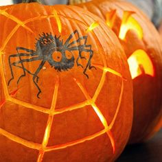 Use+a+stamp+or+a+stencil+to+add+a+big+black+spider+to+a+pumpkin+side,+and+instead+of+the+usual+eyes+and+mouth,+carve+in+the+spider's+sticky+web.