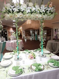 """The """"King's Table"""" -- a more social table seating for the bridal party -- as opposed to the traditional long linear table."""