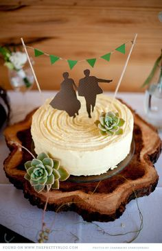 silhouette of the happy couple cake topper..this site has so much for weddings, photography and just fun ideas