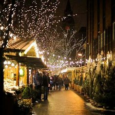 Manchester Christmas Market, the annual collection of traditional German-style food and craft market stalls in City Centre, 2010, Manchester, UK, photograph by Claire Basiuk. More
