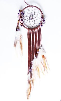 4 inch handmade Wire Wrapped Dream Catcher - wrapped in brown suede, wire wrapped in large seed beads, handmade white crystal flowers, metal leaves, brown and white hackle feathers and finished with a chain for hanging. You can purchase at https://www.facebook.com/pages/Dreamscape/471890606282556