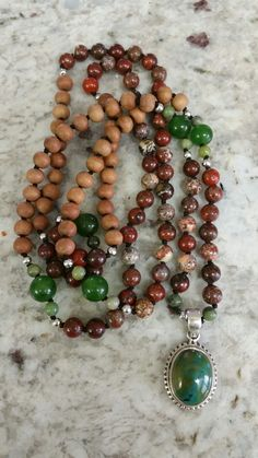 Speak your truth Mala - Created for a friend beginning to write her first book with sandalwood, poppy jasper jade and turquoise.   All beads that have properties meant to enhance a writer's talent.
