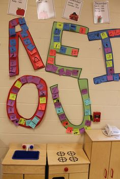 A E I O U . . . vowel posters with cooperative groups. Great idea to make vowel work meaningful.