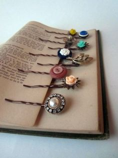 bobby pins with antique buttons, vintage jewelry, and rose cabochons: