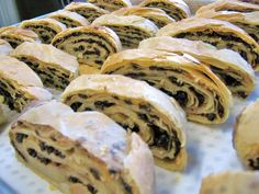 Currant Rolls. It is said that if the dough isn't flaky, the pastry isn't tasty!  This gem consists of a lovely flaky dough filled with black currants, with a sprinkle of  sugar and cinnamon. Made by & sold at Alima's Roti and Pastry 13 Kenview Blvd Brampton ONT Canada 905 791 7684 Black Currants, Bread And Pastries, Sweet Bread, Cinnamon, Gem, Bakery, Rolls, Coconut, Tasty