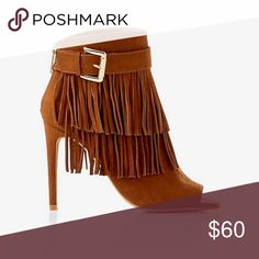 """Listing Fringed Peep Toe Buckle Bootie Fringed Peep Toe Buckle Bootie. Need a little lift in your stride? Opt for these sexy peep toes with two rows of playful fringe. Constructed with a slender heel and back zippers to slide them on and keep them in place. Heel is approx. 4"""" tall. These are so gorgeous, but sadly, slightly big on me, so they've never been worn. New in their packaging, no box. Express Shoes Ankle Boots & Booties"""
