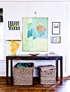 rustic credenza, baskets and pretty art