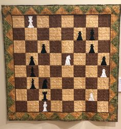 """Wall Quilt 03, """"Queen's Gambit"""" by Mary Whelan  """"When the Autumn Reverie was in full color in my hometown, it was time for us to go indoors where it was warm and bring out our board games. My brother's favorite game was always chess. My sister and I could never beat him! For this and so many other shared childhood memories, I dedicate this quilt to my big brother, Michael Kandrac, with love."""" Childhood Games, Childhood Memories, Capital City, Chess, Board Games, Brother, Quilting, Corner, Mary"""