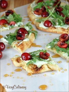 Cherry Pizza with Herbed Mascarpone and Arugula: this simple and easy, yet elegant pizza has a crispy crust, herbed spread, peppery arugula, and sweet cherries. And it's fantastic!