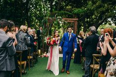 This modern wedding at the San Diego Botanic Gardens mixed Indian culture with bright and playful florals to create a fun and stylish event!