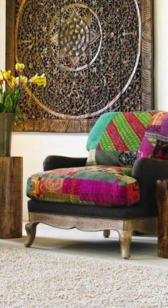 Love the wooden art piece on the wall combined with the bright colours of the chair.