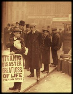 "U.S. London street scene, 1912. A newsboy holds a broadside reading, ""Titanic Disaster Great Loss of Life."""