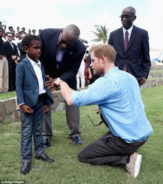 Unsure? A smartly dressed young man looked a little nervous as he met the British prince...