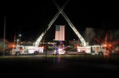 Aerial Ladder Fire Trucks salute the US flag!