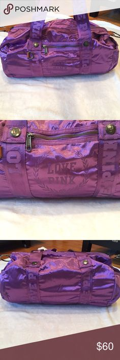 Love Pink Duffle Bag Super cute purple duffle bag! Says Love Pink on the front & all over the straps, interior, and zippers. Zipper on the front & 2 pockets on the inside. Looks brand new!! Reasonable offers accepted! PINK Victoria's Secret Bags Travel Bags