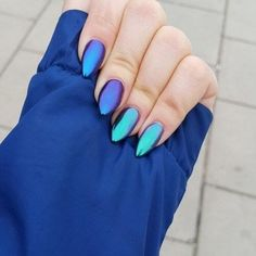 Metallic nails reflecting purple, blue and green hues