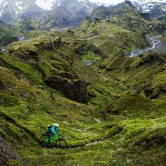 Iceland isnt on everyones bucket list for mountain biking but with never-ending summer days otherworldly landscapes and plenty of singletrack that is likely to change. This July Colorado-based @yeticycles sent photographers and filmmakers Craig Grant and @joeyschusler with pro rider @sam_seward to test out a new bike and get some jaw-dropping images. They succeeded. Photo: @joeyschusler | Full gallery at OutsideOnline.com by outsidemagazine