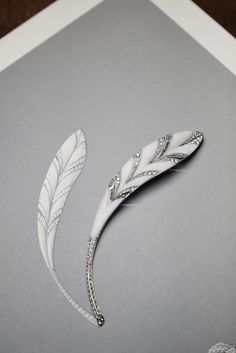 The Plume d'Aigle brooch, made of diamonds and marble, is light as a feather.