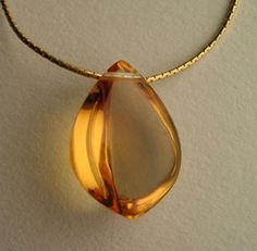 Golden Citrine Pendant - This is the sunshine stone; it carries the energy of the sun. It raises self esteem and self confidence and enhances personal power. It not only promotes joy but releases negativity. It is also excellent for energizing and recharging and reversing degenerative disease. It detoxifies the blood and fortifies the nerves. It is an excellent eliminator, helping to relieve constipation and reduce cellulite. This is the stone of empowerment!