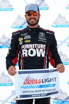 Martin Truex Jr., driver of the #78 Furniture Row/Denver Mattress Toyota, poses with the Coors Light Pole Award after qualifying in the pole position for the Monster Energy NASCAR Cup Series Apache Warrior 400 presented by Lucas Oil at Dover International Speedway on September 29, 2017 in Dover, Delaware. Aric Almirola, Austin Dillon, Bristol Motor Speedway, Martin Truex Jr, Monster Energy Nascar, Nascar Racing, Coors Light, The Row, Dover Delaware