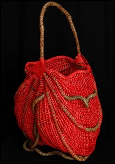 Tina Puckett   'Scarlet Red'. 2006.  Framed out of bittersweet, this basket is woven from red reeds. Branches of bittersweet protrude through the wall of the basket.
